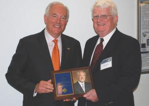 John Donnelly presenting award to A. Ross Myers. Mr Donnelly is the CEO of the L.F. Driscoll Company, LLC, a construction mangement company and one of the largest general contracting firms in the Philadelphia region.  He is a 1972 civil engineering graduate of Drexel University.