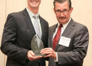 Paul Carter receives Myers-Lawson Award, presented by Robert Wells, MLSoC Industry Board Chair